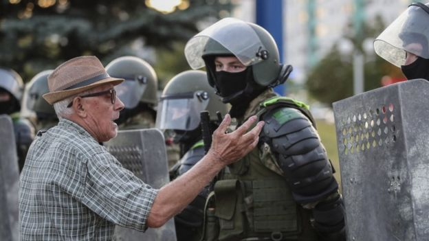 A man speaks with Belarus military special forces during a protest after the presidential election, in Minsk, Belarus, 11 August 2020