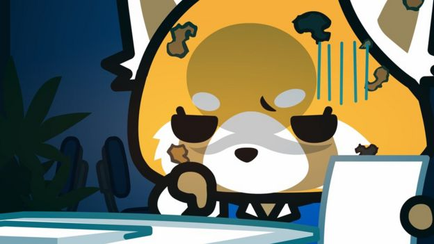 Aggretsuko, looking sad at her desk.