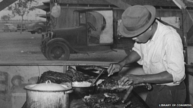 African American man slicing barbecue at a county fair in 1939
