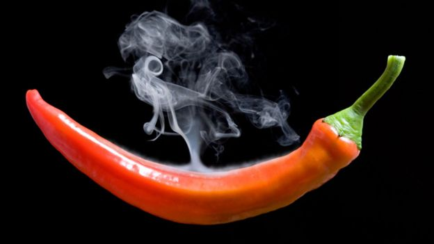 A hot pepper with coming out smoke