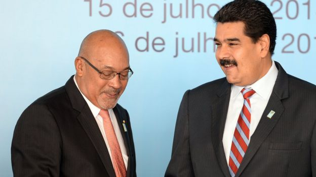 Suriname's President Desire Bouterse (L) and Venezuela's President Nicolas Maduro shake hands before the family photo of the BRICS-UNASUR Summit in Brasilia on July 16, 2014.