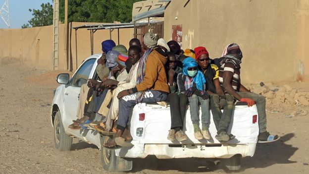 Migrants on a pick-up truck