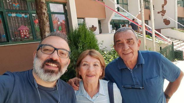 Emrah Guler with his parents