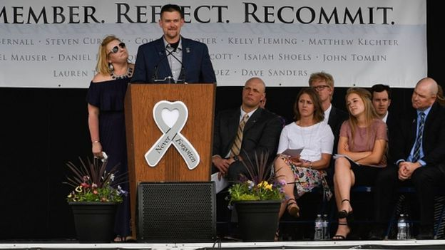 Sean Graves, a massacre survivor and 2002 graduate, speaks during the Columbine Remembrance Ceremony at Clement Park