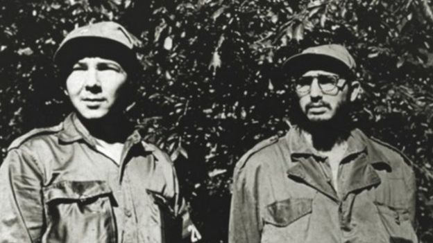 "In this undated handout file picture released by the Cuban website ""Cubadebate"" on August 5, 2010, Fidel Castro (right), his brother Raul (left) are seen in Sierra Maestra, Cuba."