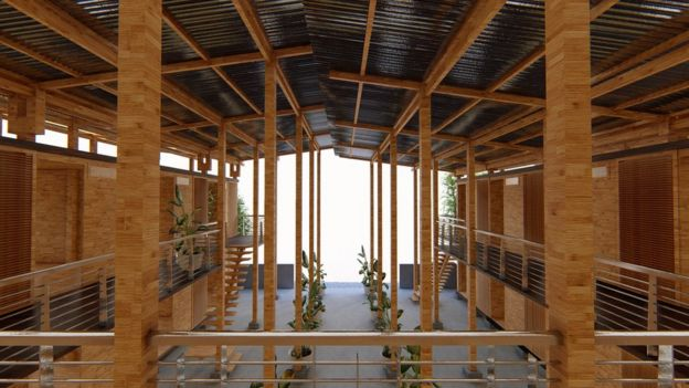 An interior view of the house shows the long stilts which stretch up from ground level to support its roof