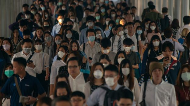A crowd wearing surgical masks in China