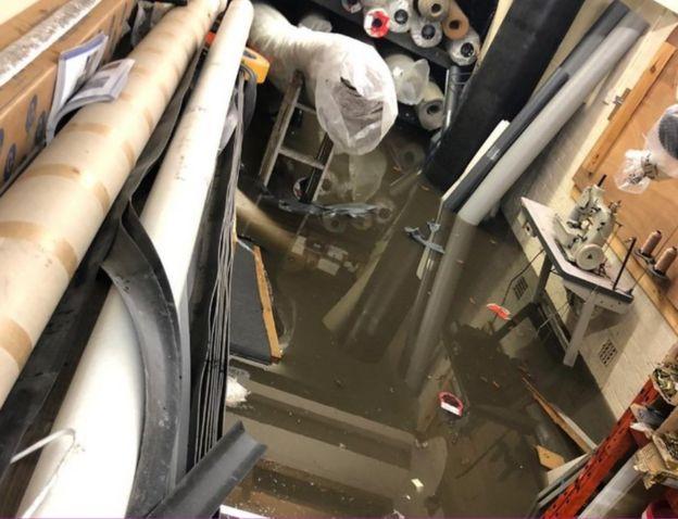 Inside flooded carpet shop