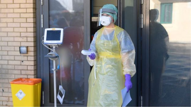An nurse during a demonstration of the coronavirus pod and Covid-19 virus testing procedures set-up beside the Emergency Department of Antrim Area Hospital