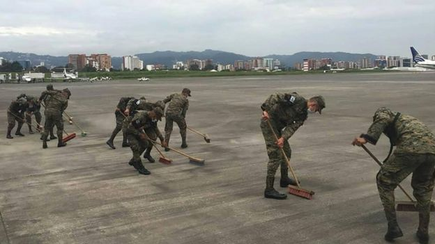 Soldiers clean ashes at Guatemala's international airport