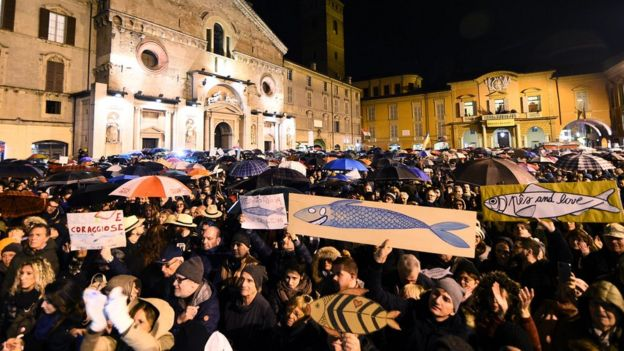 """Protesters attend a demonstration held by the """"Sardines"""", a grassroots movement against far-right League leader Matteo Salvini, in Reggio Emilia, Italy, 23 November 2019"""