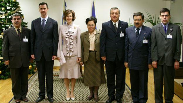 Khaled al-Ayoubi (far right) pictured with President Bashar al-Assad (second left)