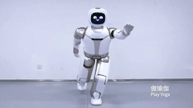 The UBTECH Walker robot pulling a yoga pose