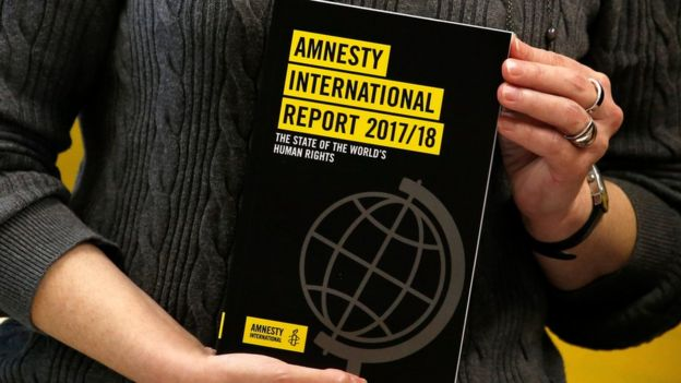 A copy of the Amnesty International Report 2017/18 is shown at a news conference in Hong Kong, China February 22, 2018