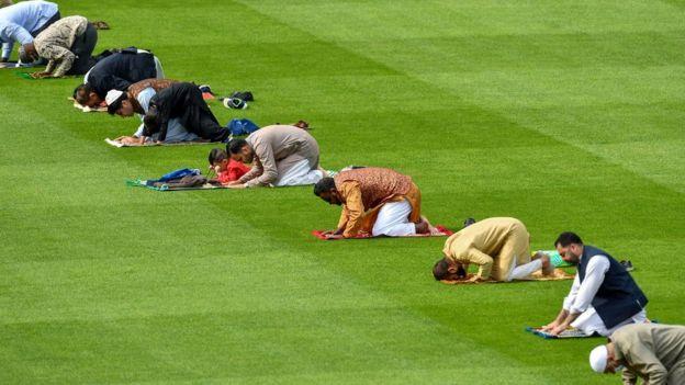 Muslim men perform Eid al-Adha prayers on Dublin's Croke Park pitch