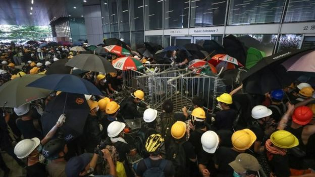 Protesters try to break into the Legislative Council building during the annual 01 July pro-democracy march in Hong Kong