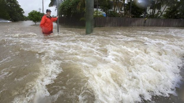 Amelia Rankin in flooded waters in Hermit Park, Townsville