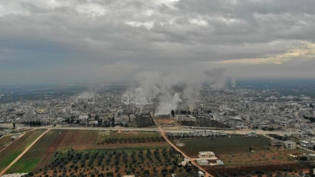 Aerial photo showing smoke rising from the Syrian town of Sarmin on 4 February 2020