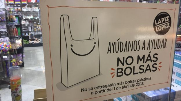"A sign reads ""Help us help: No more bags. No more plastic bags will be handed out from 1 April 2018 """