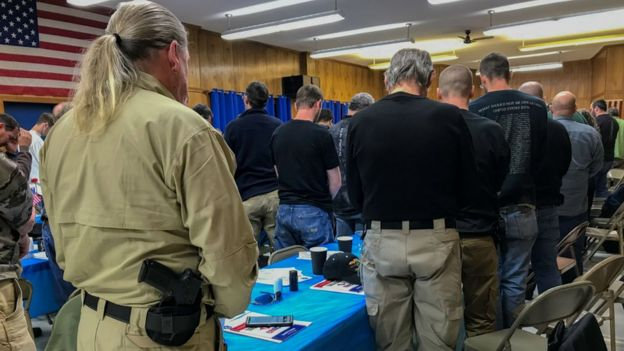 Militia groups are pictured at a meeting ahead of Monday's rally