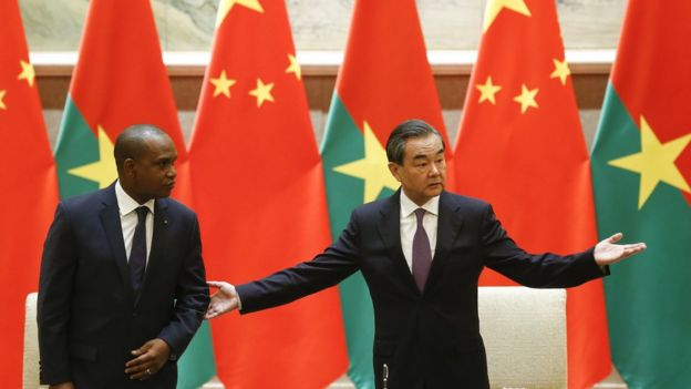 China's Foreign Minister Wang Yi (R) gestures beside Burkina Faso's Foreign Minister Alpha Barry as they attend a signing ceremony establishing diplomatic relations between the two countries in Beijing on May 26, 2018.