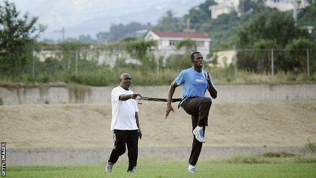 Glen Mills e Usain Bolt