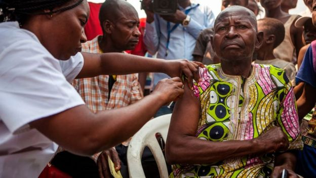 A man receives a vaccine in Kinsasa, DR Congo.