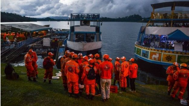 Rescue officials gather to take part in a search for survivors