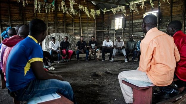 The Congo Men's Network holds a meeting with a group of local men