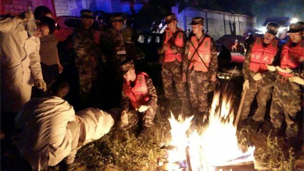 Medics treat a rescued person in Jiuzhaigou