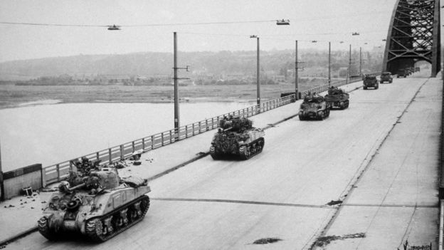 Allied Sherman tanks crossing the newly-captured bridge at Nijmegen in Holland during their advance as part of Operation Market Garden