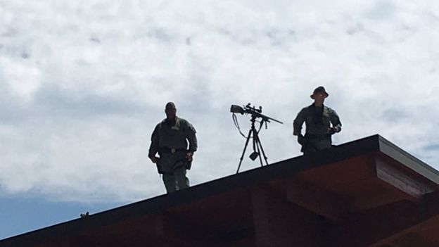 Snipers on the roof of a building in Charlottesville as march organiser Jason Kessler was prepared to speak