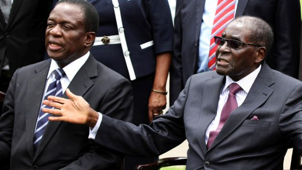 Emmerson Mnangagwa (L) and Robert Mugabe (R) pictured in 2014