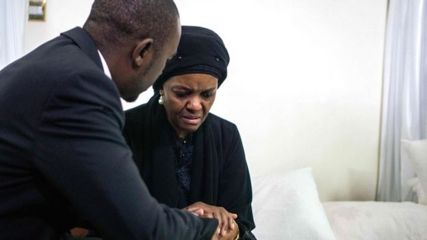 "Movement for Democratic Change opposition party leader Nelson Chamisa (L) offers his condolences to Zimbabwe's former first lady Grace Mugabe, as the body of late president Robert Mugabe lies in state at the Mugabe""s residency in Harare on September 12, 2019"