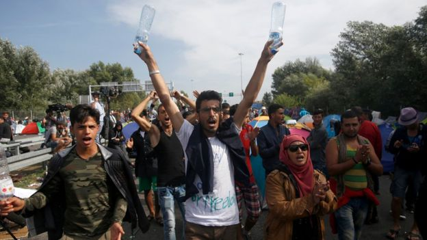 Migrants protesting at the Horgos border crossing into Hungary, in Serbia.