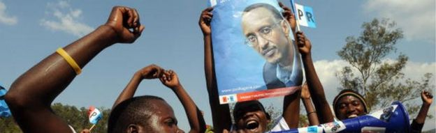 Supporters of the ruling Rwandan Patriotic Front (RPF) carry a poster as they attend a campaign rally on August 4, 2010 in Kigali ahead of next week's presidential election.