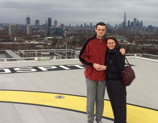 Will with his mother on top of the London hospital where he was treated