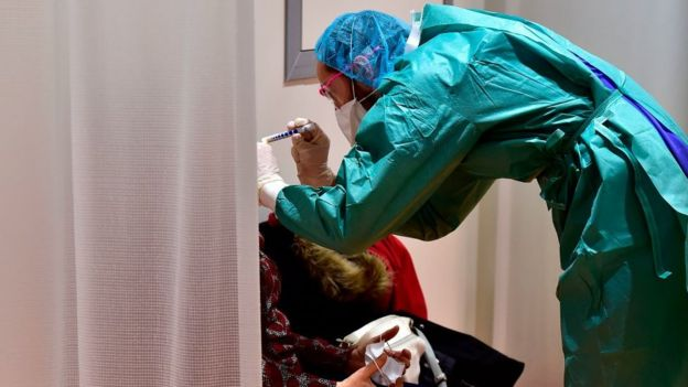 A doctor examines a patient in France