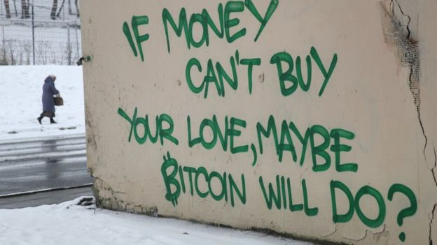 Graffiti on the outskirts of Vilnius reads: 'If money can't buy your love, maybe Bitcoin will do?', February 17 2018