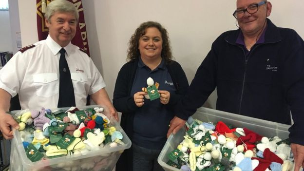 (L-R) Major Ian Davies, leader of the Salvation Army Wrexham, Karen Edwards and Peter Jones with knitted angels