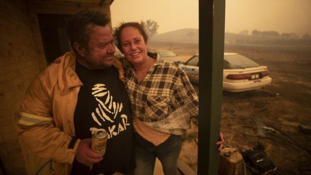 Lawrence and Claire Cowie are pictured after defending their home from a fast moving fire on Bumbalong Road, Bredbo North