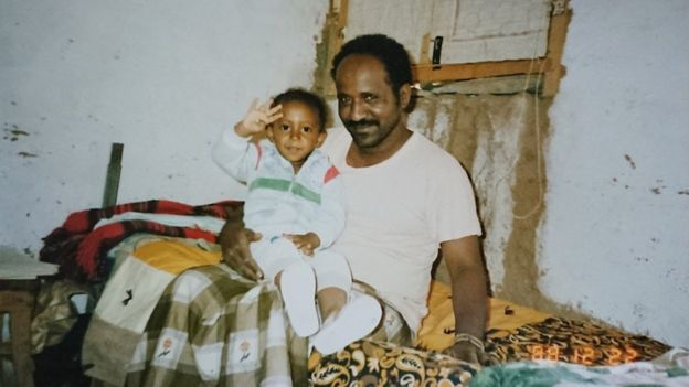 Ibrahim Sherifo as a baby with his father