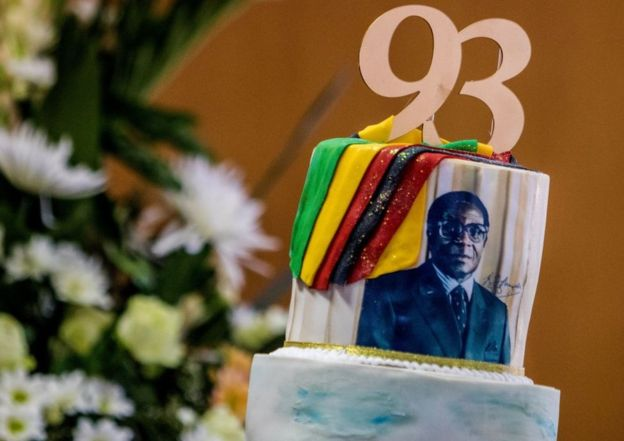 A picture taken on February 21, 2017 shows a cake bearing a portrait of Zimbabwe's President Robert Mugabe during a private ceremony to celebrate Mugabe's 93rd birthday in Harare.