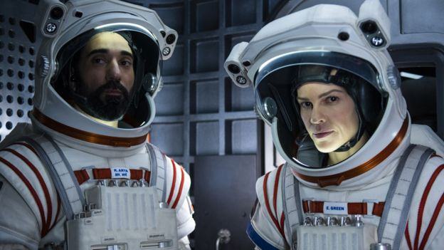 Ray Panthaki and Hilary Swank in Away