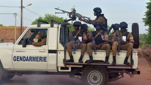 A picture take on October 30, 2018 shows Burkinabe gendarmes sitting on their vehicle in the city of Ouhigouya in the north of Burkina Faso