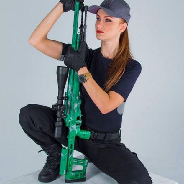 Butina with a gun