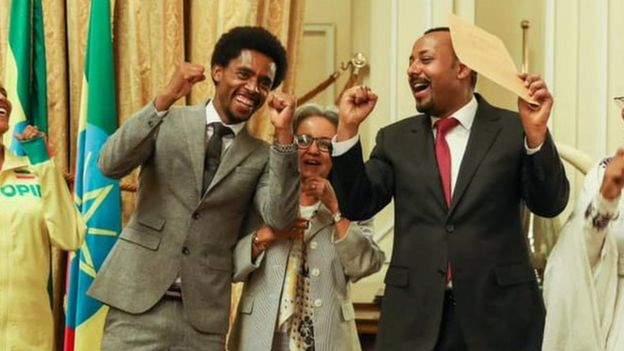 Feyisa (l) President Sahle-Work Zewde (c) and Prime Minister Abiy Ahmed (r)