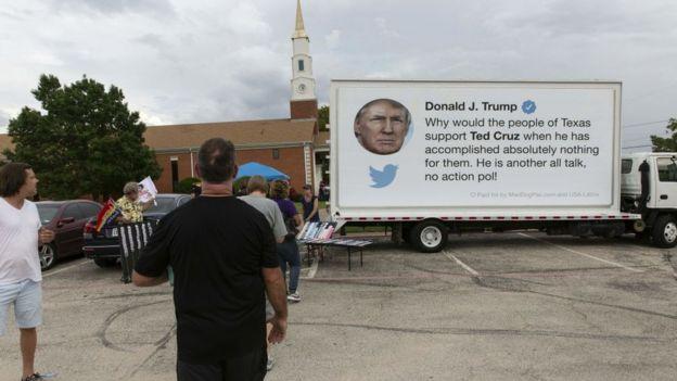 A trucks sponsored by a pro-Democrat group features a Trump tweet critical of Mr Cruz