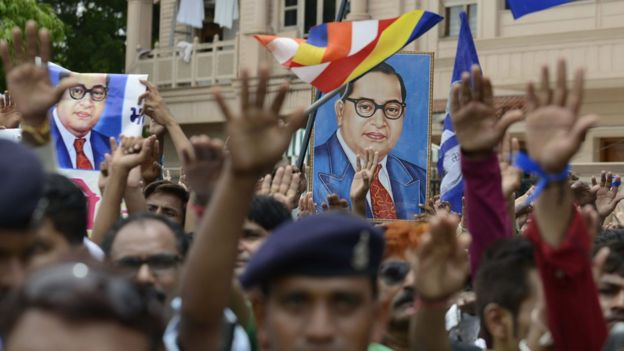 Photographs of Dr Ambedkar are raised as Dalits protest against the flogging of four men in Gujarat town on July 31, 2016