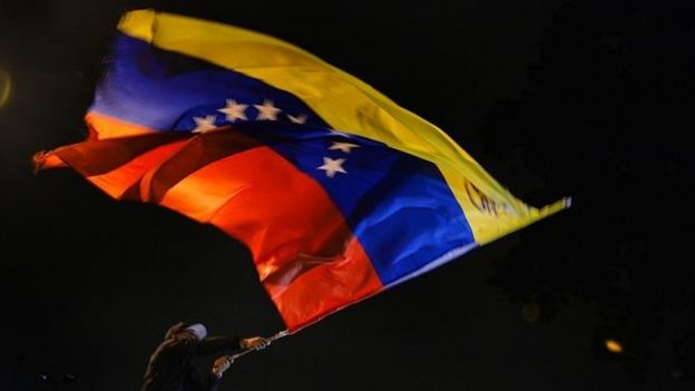 Venezuelan opposition supporters celebrate the results of the legislative election in Caracas, on the early morning December 7, 2015